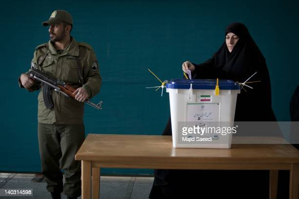 An Iranian woman casts her ballot in a polling station at the Massoumeh shrine on March 2 2012 in the religious city 130 kms east of Tehran Qom Iran...