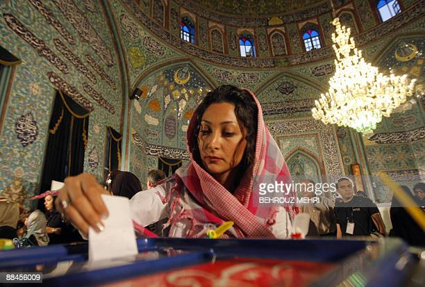An Iranian woman casts her ballot in the presidential elections in a polling station in Tehran on June 12 2009 Moderate expremier Mir Hossein Mousavi...