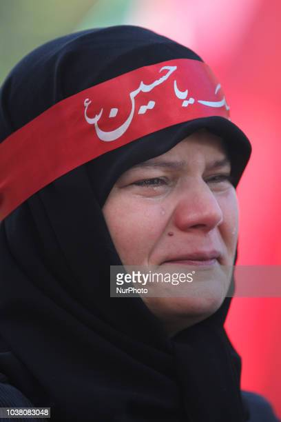 An Iranian woman cries while as an Imam recites the details of the death of the third Imam Hussein during the holy month of Muharram in Toronto...