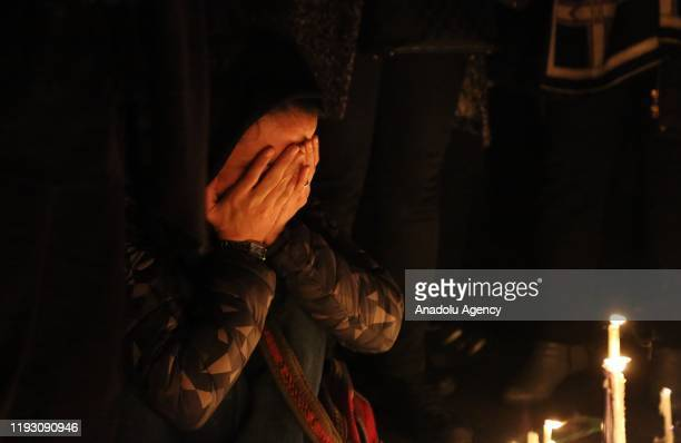 An Iranian woman gestures during a vigil held for the victims of the airplane of Ukrainian International Airlines that crashed near Imam Khomeini...