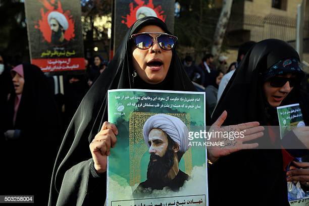 An Iranian woman holds a portrait of prominent Shiite Muslim cleric Nimr alNimr during a demonstration against his execution by Saudi authorities on...