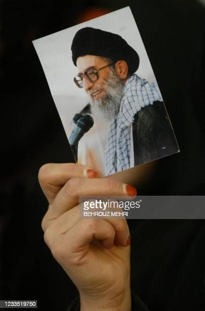 An Iranian woman holds a portrait of the Islamic republic's supreme leader Ayatollah Ali Khamenei at Imam Khomeini's mausoleum south of Tehran during...