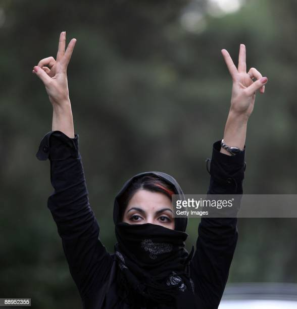An Iranian woman holds her hands in the air and makes V signs as she protests in the streets on July 9 2009 in Tehran Iran Following the recently...