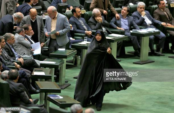 An Iranian woman lawmaker walks during a parliament session in the capital Tehran on February 4, 2019.
