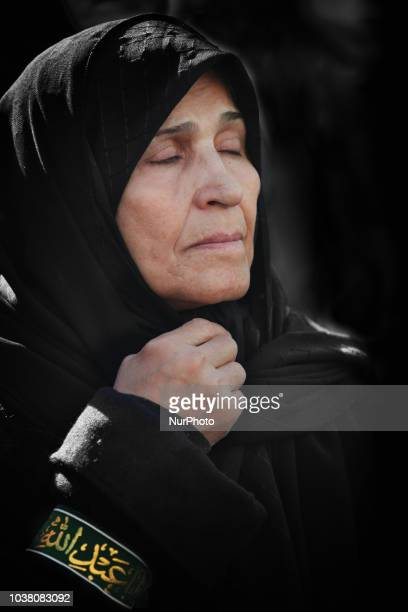 An Iranian woman listens as an Imam recites the details of the death of the third Imam Hussein during the holy month of Muharram in Toronto Ontario...