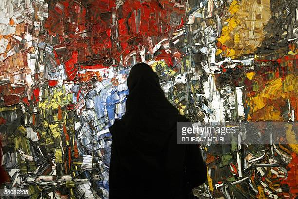 An Iranian woman looks at JeanPaul Riopelle's painting Baubess displayed at the Modern Art Movement exhibition at Tehran's Museum of Contemporary Art...