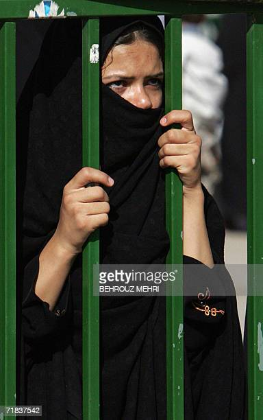 An Iranian woman looks at the Jamkaran mosque outside the religious city of Qom 120 kms south of Tehran 08 September 2006 Hundreds of thousands of...