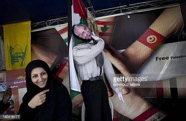 An Iranian woman points at an effigy of Israeli Prime Minister Benjamin Netanyahu in an street exhibition during the 'Quds Day' rally an antiIsraeli...
