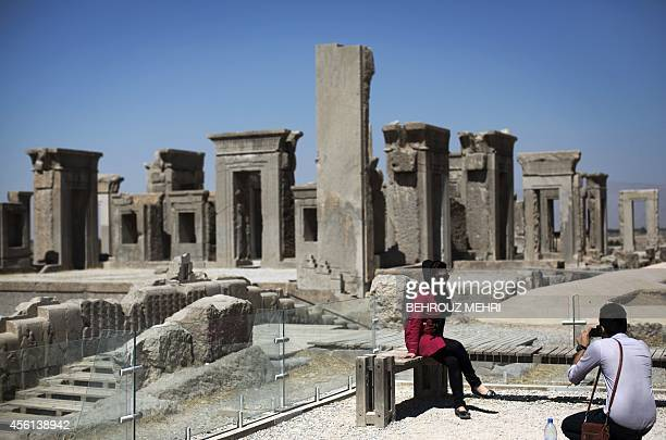 An Iranian woman poses for a photo at the ruins of Persepolis near Shiraz in southern Iran on September 26, 2014. Persepolis, is one of the greatest...
