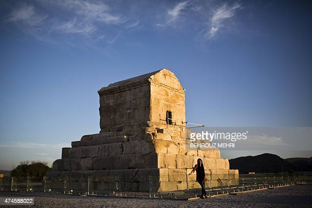 An Iranian woman poses for a picture on May 19 in front of the tomb of Cyrus II of Persia known as Cyrus the Great the founder of the Persian...