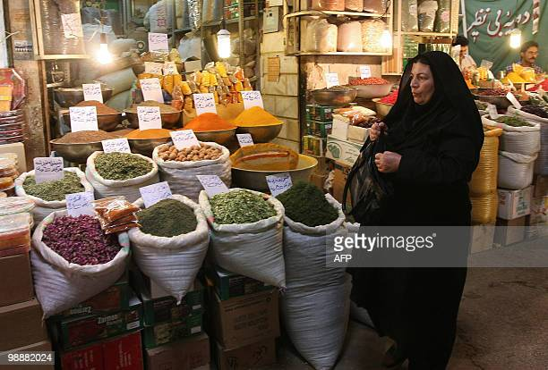 An Iranian woman shops at a bazaar in Isfahan on July 7, 2009. French President Nicolas Sarkozy demanded that Iran release 23-year-old French...