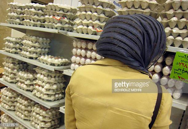 An Iranian woman shops at a supermarket in Tehran 11 October 2007 Iran's inflation rate reached 158 percent in the 12 months ending in late September...