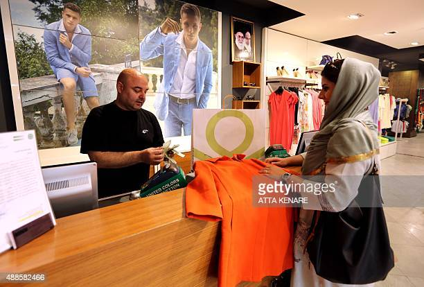 An Iranian woman shops for clothes at a Benetton store in the north of the capital Tehran on August 19 2015 Experts say the expected lifting of...