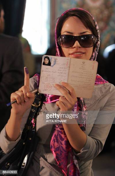An Iranian woman shows the ink on her finger after voting at a polling station in Tehran on June 12 2009 Hundreds of voters were standing outside one...