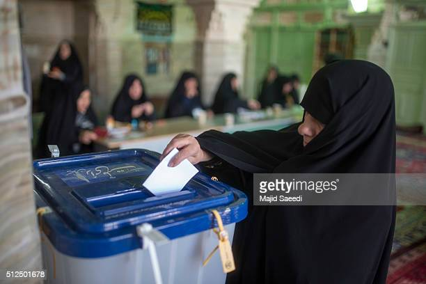 An Iranian woman votes in the parliamentary and Experts Assembly elections at a polling station in Qom 125 kilometers south of the capital Tehran...