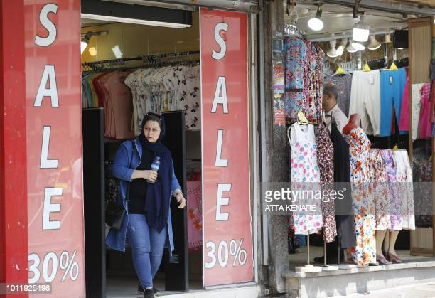 An Iranian woman walk out of a ladies clothing shop in central Tehran on August 6 2018 Iranian Foreign Minister Mohammad Javad Zarif said today that...