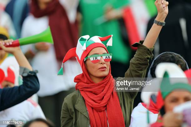 An Iranian Women's fan cheers during the FIFA World Cup Qualifier match between Iran and Cambodia at Azadi Stadium on October 10, 2019 in Tehran,...