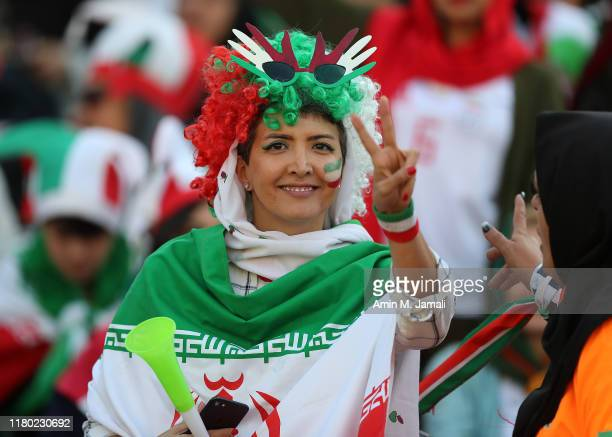 An Iranian Women's fan looks on during the FIFA World Cup Qualifier match between Iran and Cambodia at Azadi Stadium on October 10, 2019 in Tehran,...