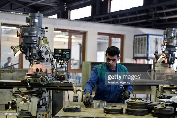 An Iranian worker works at Alumroll Novin Aluminum Factory in Arak Iran on October 6 2016 Alumroll Novin Aluminum Factory employs 750 workers and...