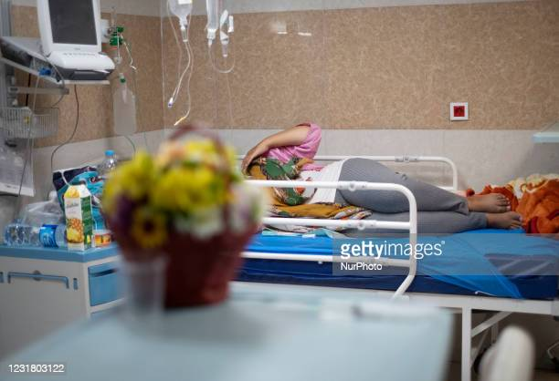An Iranian-Arab pregnant who has infected with the new coronavirus disease lies on a hospital bed in a COVID-19 ward in Razi Teaching Hospital in the...