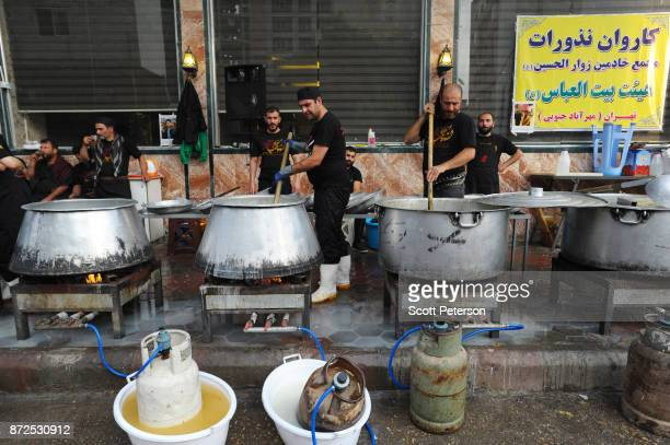 An IranianIraqi cooperation association prepares food for Shiite pilgrims marching to the shrine of Imam Hossein to commemorate arbaeen the fortieth...