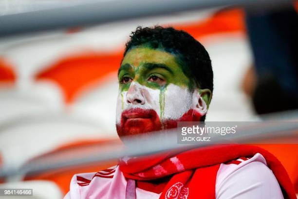 TOPSHOT An Iran's fan reacts at the end of the Russia 2018 World Cup Group B football match between Iran and Portugal at the Mordovia Arena in...