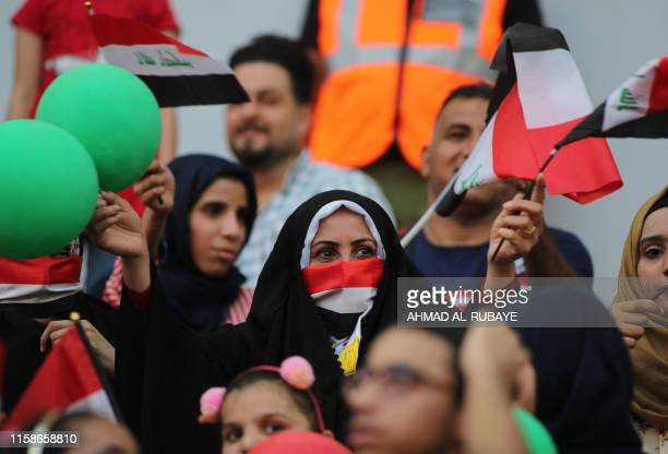 An Iraq supporter looks on during the the 2019 WAFF Championship football match between Iraq and Lebanon at the Karbala sports city on July 30 2019