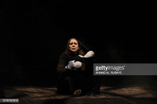 An Iraqi actress performs a play entitled 'Girls of Baghdad' at the National Theater in central Baghdad on January 7 2019 The play depicts the fate...