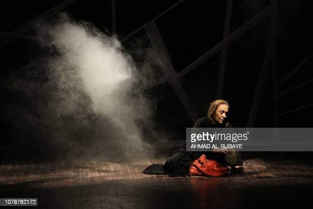 An Iraqi actress performs in a play entitled 'Girls of Baghdad' at the National Theater in central Baghdad on January 7 2019 The play depicts the...
