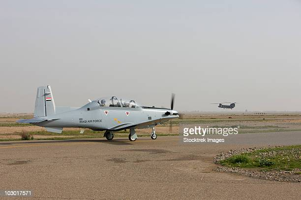 An Iraqi Air Force T-6 Texan trainer aircraft taxis out for a flight over Tikrit, Iraq.