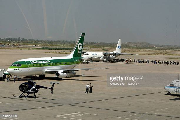 An Iraqi airway plane prepares to take off at Baghdad International Airport 18 September 2004 Iraq's national carrier launched its first...