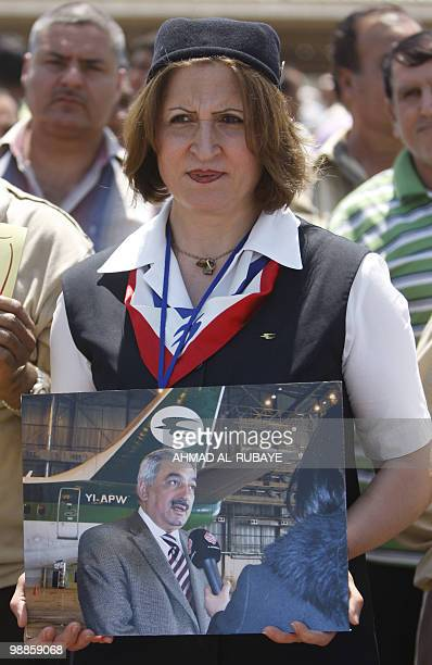 An Iraqi Airways hostess holds a picture of the airline's chief executive Kifah Hassan Jabbar during a demonstration at Baghdad airport on May 5 2010...