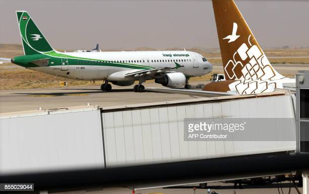 An Iraqi airways plane is pictured on the tarmac at Arbil airport in the capital of Iraq's autonomous northern Kurdish region on September 28 2017...