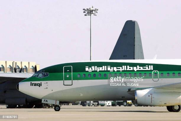An Iraqi airways plane is seen moments after it landed at Basra airport 500 kilometers south of Baghdad 01 January 2005 Iraq's national carrier Iraqi...