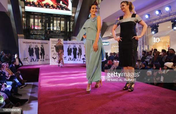 An Iraqi and an Iranian model present creations by two Iranian female fashion designers during a show at a shopping mall in the Iraqi capital Baghdad...