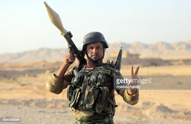 An Iraqi armed soldier flashes victory sign after Iraqi forces have entered the northern town of Amirli which had been under the siege of Islamic...