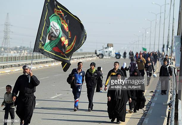 An Iraqi armoured vehicle is stationed along the main highway that links the Iraqi capital Baghdad with the central shrine city of Karbala to help in...