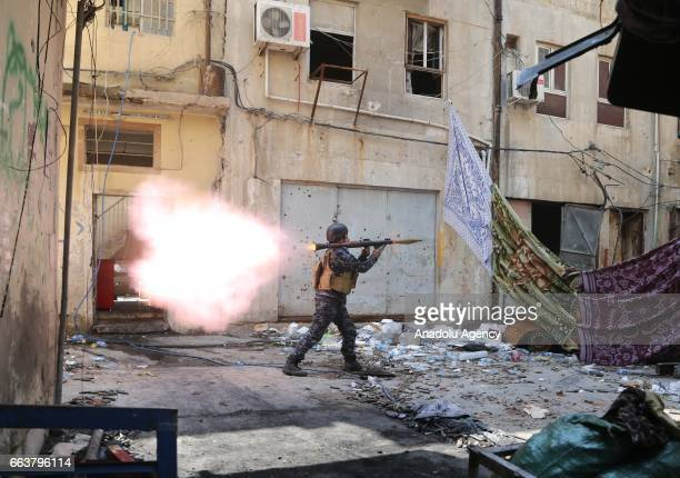An Iraqi Army member launches a rocket during the operation to retake Mosul from Daesh terrorists in Jadid neighborhood as the clashes between Iraqi...