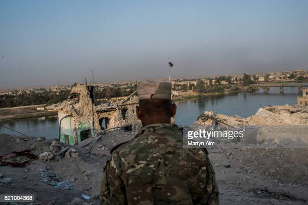 An Iraqi Army soldier in the destroyed Old City district beside the Tigris River on July 22 2017 in Mosul Iraq Despite the declared liberation of...