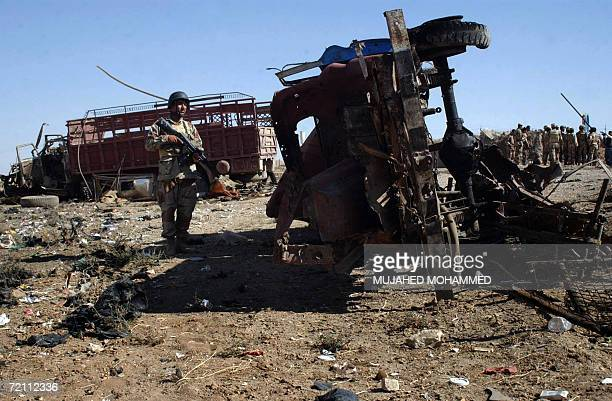 An Iraqi army soldier inspects the wreckage of a truck at the site where a suicide truck bomber ploughed into an Iraqi army post killing 14 people in...