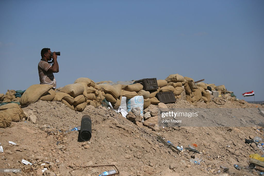 An Iraqi Army soldier observes as fellow troops assault ISIL fighters on the frontline on April 14, 2015 near Al-Karmah, in Anbar Province, Iraq. Iraqi government forces are assaulting ISIL fighters on frontline positions which were established last year when ISIL captured much of the province.