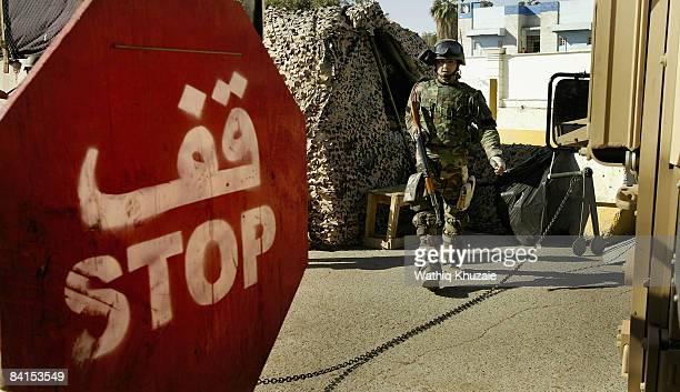 An Iraqi army soldier stands guard at the Green Zone gate on January 1 2009 at the Green Zone area in Baghdad Iraq The US handed over on January 1...