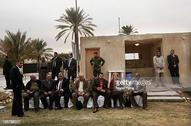 An Iraqi Army special forces soldier keeps watch at a women's art exhibition sponsored by Iraqi Parliament member Safi Asiheil in a posh Baghdad...
