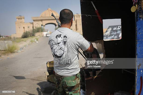 An Iraqi Badr Brigade militiaman guards the palace compound of former Iraqi President Saddam Hussein on April 9 2015 in Tikrit Iraq Iraqi government...