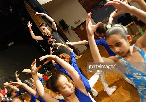 An Iraqi ballet teacher gives instructions to Iraqi dancers who are members of the 'dreaming butterfly' ballet troupe March 26 2006 in Baghdad Iraq...