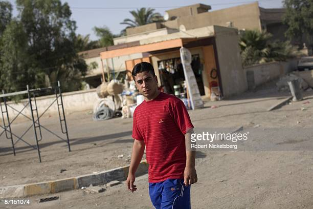 An Iraqi boy crosses the street outside an Iraqi Army command post in Sadr City the 25 million Shia dominated stronghold of cleric Moktada alSadr May...