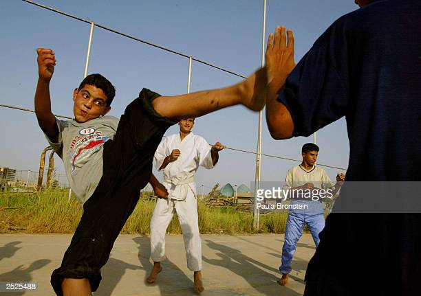 An Iraqi boy practices his kicks during a karate class with the Al Jewiya Sports Club September 22 2003 in Baghdad Iraq The class started a week...