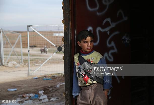 An Iraqi boy standing in front of a makeshift house at the Bahirka Refugee Camp where Christian families from Mosul's Hemdaniye town Shabaks and...