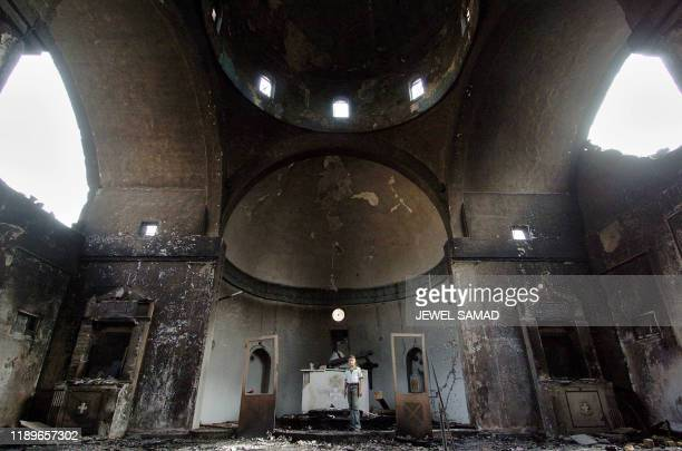 An Iraqi boy stands amidst the derbies of the Roman Catholic St George's church built in 1943 following an explosion in the Karrada neighborhood of...