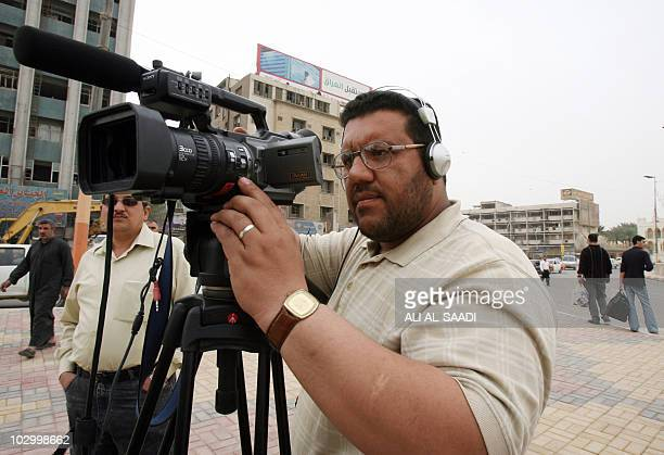 An Iraqi cameraman for Biladi TV station shoots with his camera in central Baghdad on March 11 2008 Freedom of the press flourished after Saddam...